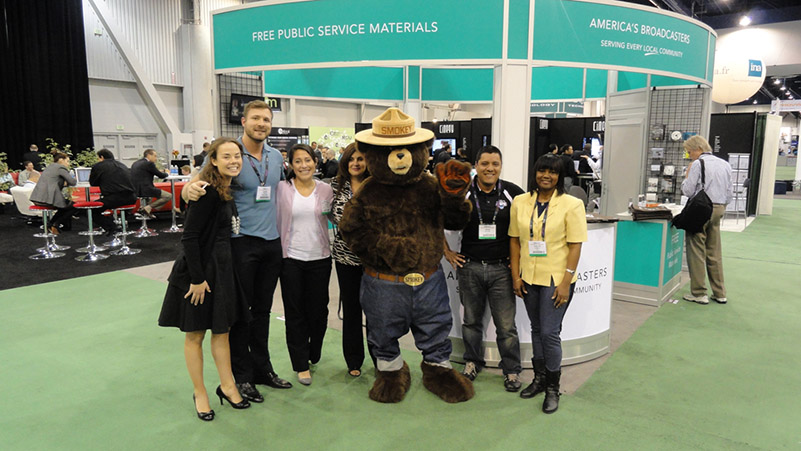 (left to right), Allison Kreutzjans from the NAB, Justin Smith from the Three Agency, Avele Conlogue from the American Red Cross, Maria Soto from the Plowshare Group, Smokey Bear,  Mark Salazar from TEAM Coalition and Evelyn Conerly from the EPA.