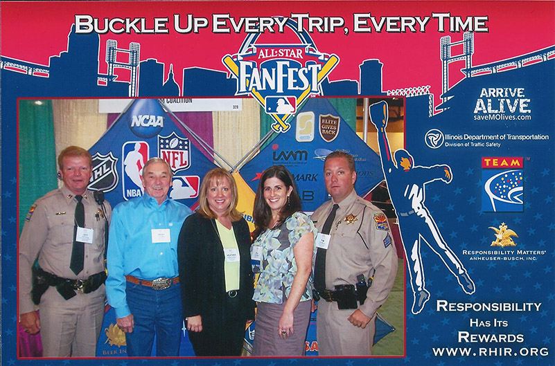 Officers from the Arizona Highway Patrol (Jeff King on the left and Tim Mason on the right), Bear Kay of the Colorado State Patrol and the Heather Halpape of the Colorado Department of Transportation join Jill Pepper from TEAM for a photo, with the MLB photo border.