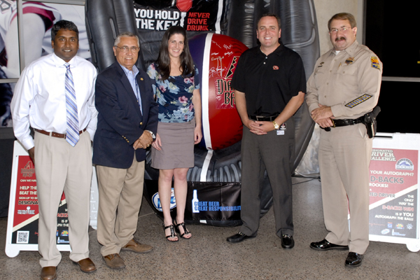 (left to right: Raj Kandyil, General Manager for MillerCoors in Arizona; Alberto Gutier, Director of the Arizona Governor's Office of Highway Safety; Jill Pepper, Executive Director of TEAM Coalition; Derrick Hall, President and CEO of the Arizona Diamondbacks; Colonel Robert Halliday, Director of the Arizona Department of Public Safety