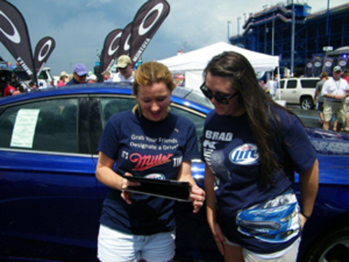 A fan at Kentucky Speedway takes the pledge to be a designated driver