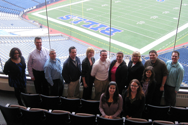 Ralph Wilson Stadium IDP attendees enjoy a bright sun-shiny day overlooking the Bills playing field.