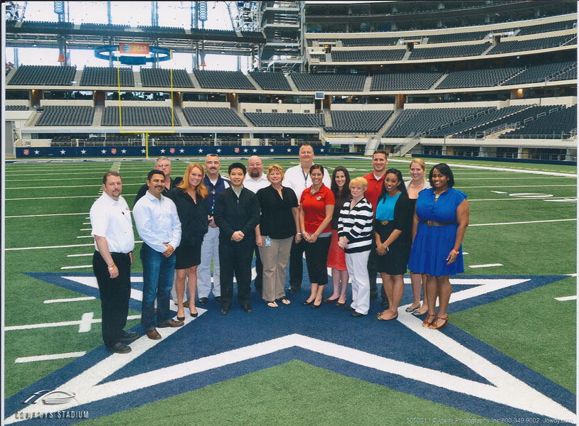 Cowboys Stadium IDP attendees pose for a photo on the famous Cowboys Star.