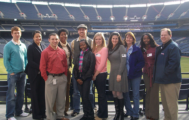 Atlanta IDP attendees stop for a quick photo with a beautiful view of Turner Field.