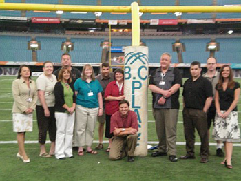 TEAM IDP participants pose on the field at BC Place Stadium, the home of the BC Lions