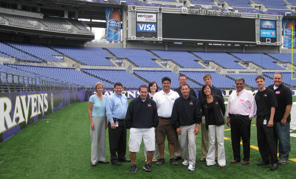 Baltimore IDP attendees enjoy a moment on the field at M&T Bank Stadium, home of the NFL Baltimore Ravens.