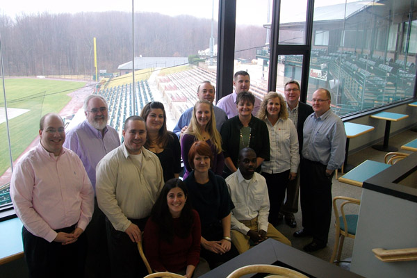 Bowie IDP attendees visit the Diamondview Restaurant at Prince George's Stadium for a quick photo.