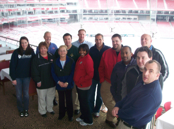 Cincinnati IDP attendees show off the view of the winter wonderland at Great American Ball Park.