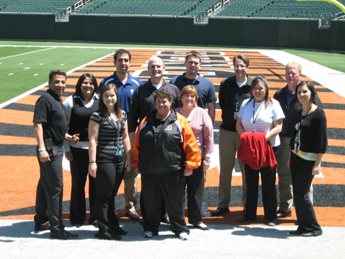 TEAM IDP participants stand on the sideline on the field of Paul Brown Stadium