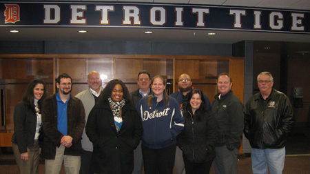 Detroit IDP attendees visit the Tigers clubhouse for a quick photo.