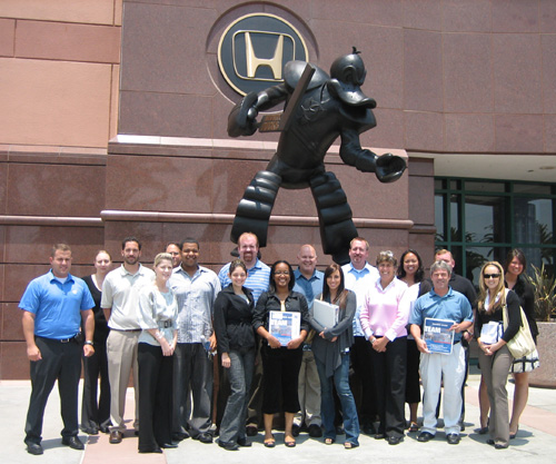 TEAM IDP participants proudly stand in front of the Mighty Duck statue outside Honda Center