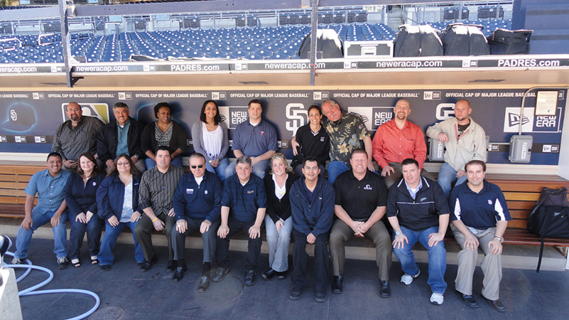 San Diego IDP attendees visit the Padres dugout for a quick photo.