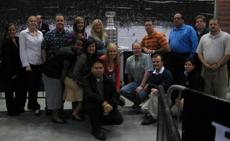 TEAM IDP participants pose with the fabled Stanley Cup at the Honda Center
