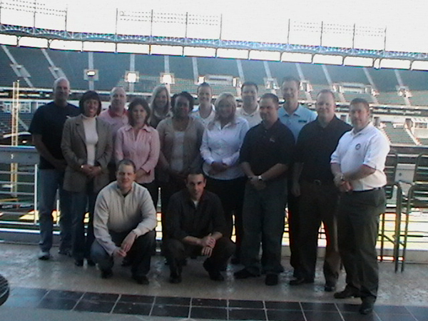 TEAM IDP participants stand on the concourse of Rangers Ballpark