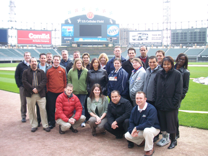 Days before the field is slated to be resodded, TEAM IDP participants pose at U.S. Cellular Field